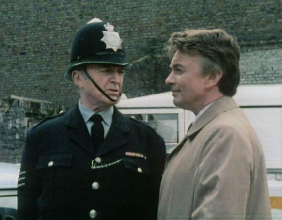 Dixon (Jack Warner) and Crawford (Peter Byrne)
