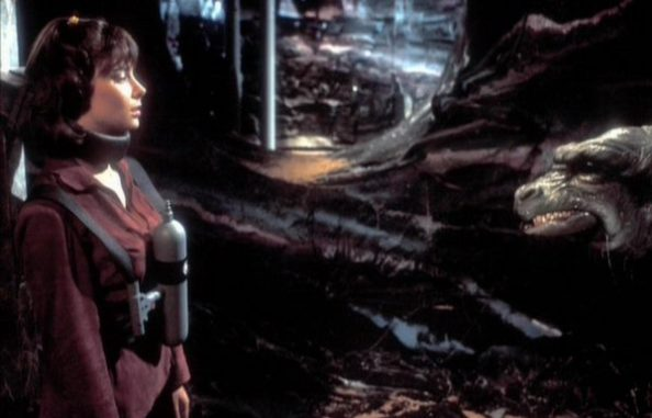 Poor Peri is menaced by an unconvincing rubber monster.  The fate of Doctor Who companions down the ages.